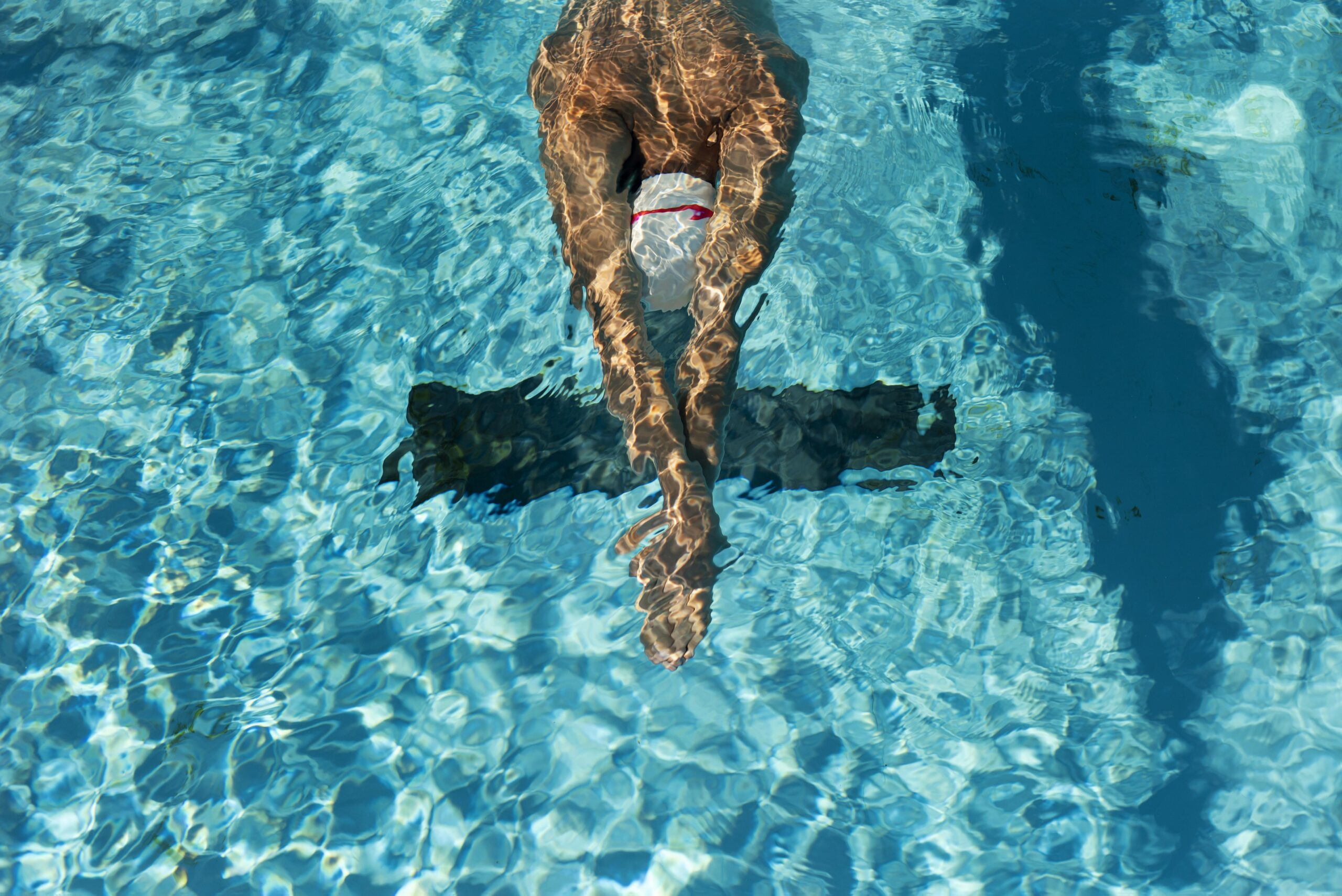 high angle male swimmer water pool scaled